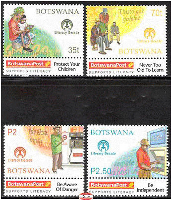 four stamps depicting literacy